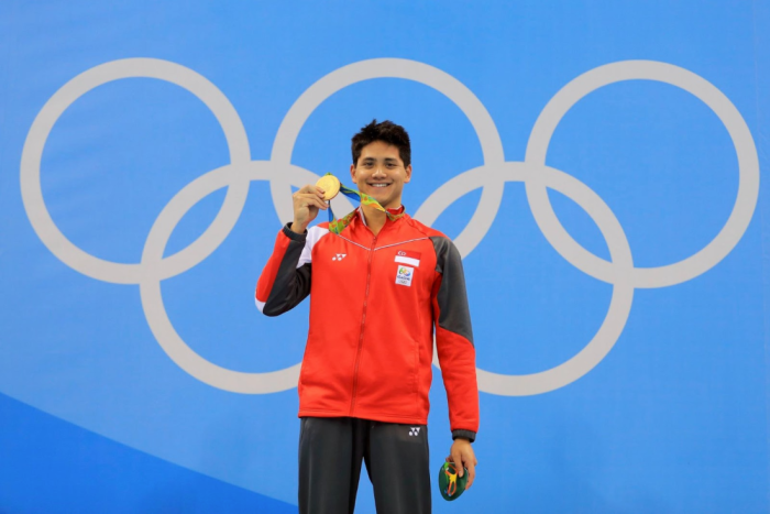 Joseph Schooling shows his gold medal
